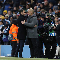 FC Schalke 04 manager Domenico Tedesco (left) and Manchester City manager Josep Guardiola share a moment at the final whistle<br /> <br /> Photographer Rich Linley/CameraSport<br /> <br /> UEFA Champions League Round of 16 Second Leg - Manchester City v FC Schalke 04 - Tuesday 12th March 2019 - The Etihad - Manchester<br />  <br /> World Copyright © 2018 CameraSport. All rights reserved. 43 Linden Ave. Countesthorpe. Leicester. England. LE8 5PG - Tel: +44 (0) 116 277 4147 - admin@camerasport.com - www.camerasport.com