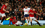 Tottenham Hotspur's Son Heung-Min (C) is challenged by Manchester United's Daniel James (R) and Manchester United's Fred during the Premier League match at Old Trafford, Manchester. Picture date: 4th December 2019. Picture credit should read: Darren Staples/Sportimage