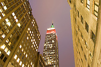 AVAILABLE FROM JEFF AS A FINE ART PRINT.<br /> <br /> AVAILABLE FROM CORBIS FOR COMMERCIAL AND EDITORIAL LICENSING.  Please go to www.corbis.com and search for image # 42-19640966.<br /> <br /> Upward View of the Empire State Building at Dusk, Illuminated Red and Green for Christmas