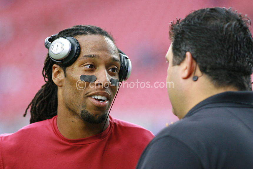 Nov 23, 2008; Glendale, AZ, USA; Arizona Cardinals wide receiver Larry Fitzgerald (left) talks with FOX analyst Tony Siragusa prior to a game against the New York Giants at University of Phoenix Stadium.  Mandatory Credit: Chris Morrison-US PRESSWIRE