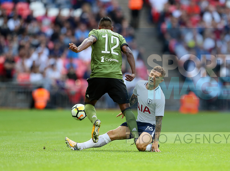 Tottenham's Kieran Trippier tussles with Juventus Alex Sandro and goes off injured during the pre season match at Wembley Stadium, London. Picture date 5th August 2017. Picture credit should read: David Klein/Sportimage