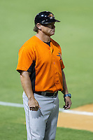 Frederick Keys hitting coach Torre Tyson (13) of the Frederick Keys coaches third base during the game against the Winston-Salem Dash at BB&T Ballpark on July 29, 2014 in Winston-Salem, North Carolina.  The Dash defeated the Keys 4-0.   (Brian Westerholt/Four Seam Images)