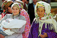 Locals wearing traditional clothing in Samarkand, Uzbekistan