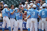 Tyler Lynn (14) of the North Carolina Tar Heels is greeted by his teammates after hitting a home run against the Florida State Seminoles in the 2017 ACC Baseball Championship Game at Louisville Slugger Field on May 28, 2017 in Louisville, Kentucky. The Seminoles defeated the Tar Heels 7-3. (Brian Westerholt/Four Seam Images)