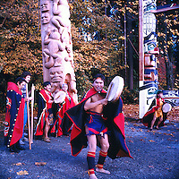 Stanley Park, Vancouver, BC, British Columbia, Canada - Native American Indians erecting  Nisga'a Totem Pole in Ceremony at Brockton Point