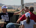 A man tries to pull a whistle from the mouth of protestor Bob Fulkerson during the Basque Fry at the Corley Ranch  in Gardnerville, Nevada on Saturday, August 26, 2017.