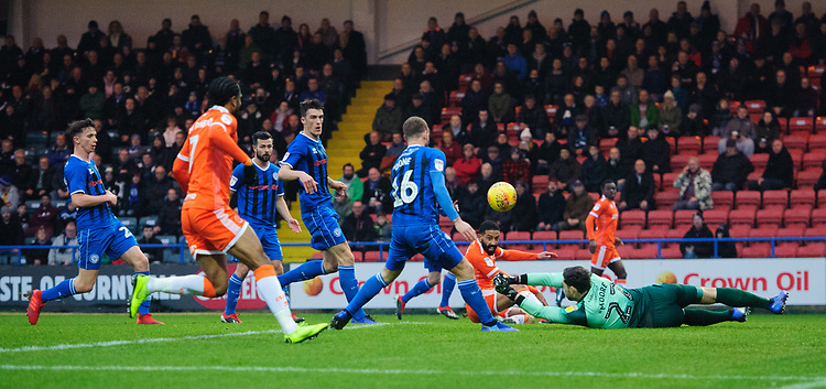 Blackpool's Liam Feeney watches as Rochdale's Brendan Moore pushes the ball clear<br /> <br /> Photographer Chris Vaughan/CameraSport<br /> <br /> The EFL Sky Bet League One - Rochdale v Blackpool - Wednesday 26th December 2018 - Spotland Stadium - Rochdale<br /> <br /> World Copyright © 2018 CameraSport. All rights reserved. 43 Linden Ave. Countesthorpe. Leicester. England. LE8 5PG - Tel: +44 (0) 116 277 4147 - admin@camerasport.com - www.camerasport.com