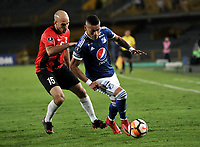 BOGOTA - COLOMBIA – 17 - 04 - 2018: Ayron del Valle (Der.) jugador de Millonarios (COL), disputa el balon con Ricardo Andreutti (Izq.) jugador de Deportivo Lara (VEN), durante partido entre Millonarios (COL) y Deportivo Lara (VEN), de la fase de grupos, grupo G, fecha 3 de la Copa Conmebol Libertadores 2018, en el estadio Nemesio Camacho El Campin, de la ciudad de Bogota. / Ayron del Valle (R) player of Millonarios (COL), figths for the ball with Ricardo Andreutti (L) player of Deportivo Lara (VEN), during a match between Millonarios (COL) and Deportivo Lara (VEN), of the group stage, group G, 3rd date for the Conmebol Copa Libertadores 2018 in the Nemesio Camacho El Campin stadium in Bogota city. VizzorImage / Luis Ramirez / Staff.