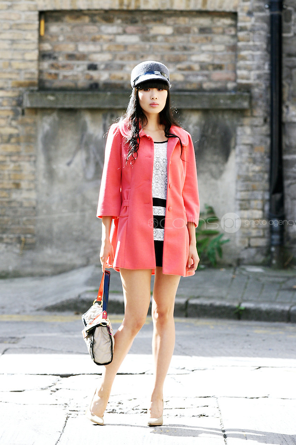 NO REPRO FEE.30/8/2010. AWEAR AUTUMN COLLECTION. Yomiko Chen models a selection of dresses from A|wear's new autumn '10 collection in Dublin.Yomiko Chen wears Lace shift dress - EUR40 Coral bow coat - EUR50 Peak cap - EUR15.  The collection arrives instore and onwww.awear.com from this week.  Picture James Horan/Collins Photos