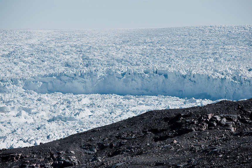 The head of the Ilulissat glacier, West Greenland, August 2011. For scale, the wall stands roughly 50m above the flow of the ice fjord below. The Ilulissat glacier has accelerated by at least two times since 2001. Photo: Ed Giles.