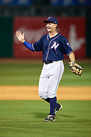 Northwest Arkansas Naturals center fielder Donald Dewees Jr. (16) celebrates with his teammates after the final out of a game against the Midland RockHounds on May 27, 2017 at Arvest Ballpark in Springdale, Arkansas.  NW Arkansas defeated Midland 3-2.  (Mike Janes/Four Seam Images)