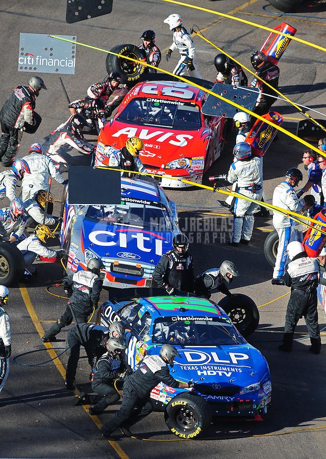 Nov. 8, 2008; Avondale, AZ, USA; NASCAR Nationwide Series drivers Denny Hamlin (18) Jamie McMurray (17) and David Stremme (64) pit during the Hefty Odor Block 200 at Phoenix International Raceway. Mandatory Credit: Mark J. Rebilas-