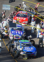 Nov. 8, 2008; Avondale, AZ, USA; NASCAR Nationwide Series drivers Denny Hamlin (18) Jamie McMurray (17) and David Stremme (64) pit during the Hefty Odor Block 200 at Phoenix International Raceway. Mandatory Credit: Mark J. Rebilas-