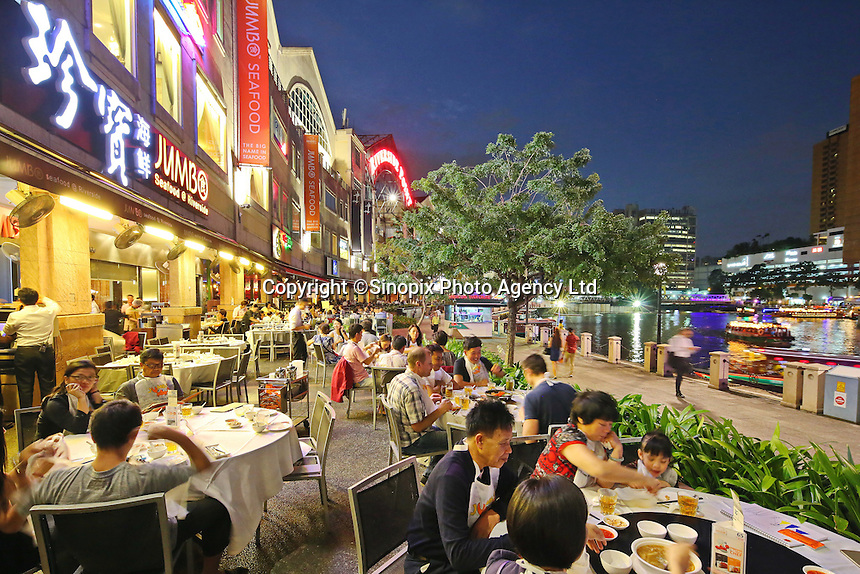 Diners sit outside at the Jumbo Seafood chain in Singapore, in Singapore, 14 March 2015.