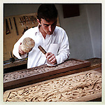 ** TO GO WITH AFGHANISTAN STORY FOR PETER MURTAGH - NO ARCHIVE, NO RESALE ** A young man practices his carving at the Turquoise Mountain foundation in Kabul, 26 August 2012. The Tirquoise Mountain is dedicated to preserving the arts and design of Afghan culture. (John D McHugh)