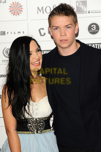 guest & Will Poulter.The 14th Moet British Independent Film Awards 2011, Old Billingsgate, London, England..December 4th, 2011.half length black dress suit white belt blue skirt.CAP/CJ.©Chris Joseph/Capital Pictures.