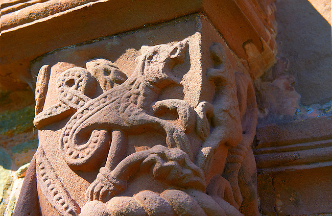 Norman Romanesque relief sculptures of mythical dragon from the south doorway of the Church of St Mary and St David, Kilpeck Herifordshire, England. Built around 1140