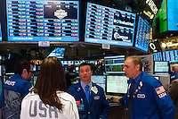 U.S. Women's National Team midfielder Carli Lloyd talks with Frank Masello and Geoffrey Freedman of Barclays after ringing the closing bell of the NYSE during the centennial celebration of U. S. Soccer at the New York Stock Exchange in New York, NY, on April 02, 2013.