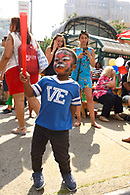 Candid image of young boy with painted face.
