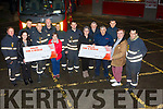 Tralee Fire and Rescue with a cheques in the amount of €3243 each, to Margaret Kelly and Maria O'Brien from the Emily Ward and to Breda Dyland and Dan Horan of the Kerry Link Cancer Bus at the Firs Station on Monday night.