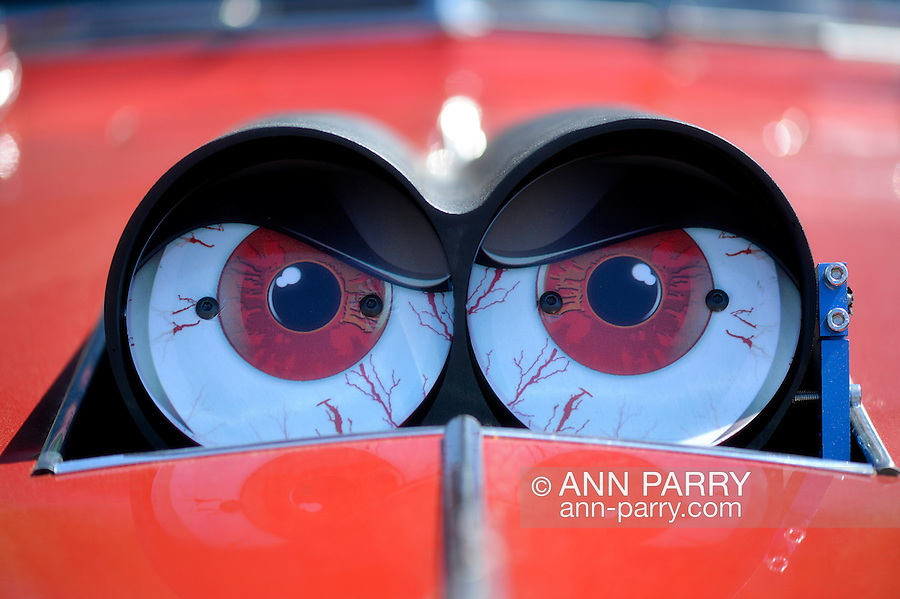 Westbury, New York, USA. June 12, 2016. Funny red eyeballs decorate Scoop Flaps of carb Shot Gun style Hood Scoop modification on red 1940 Chevrolet Special Deluxe sedan, at the Antique and Collectible Auto Show at the 50th Annual Spring Meet at Old Westbury Gardens, in the Gold Coast of Long Island, and sponsored by Greater New York Region, GNYR, Antique Automobile Club of America, AACA. Participating vehicles in the judged show included hundreds of domestic and foreign, antique, classic, collectible, and modern cars.