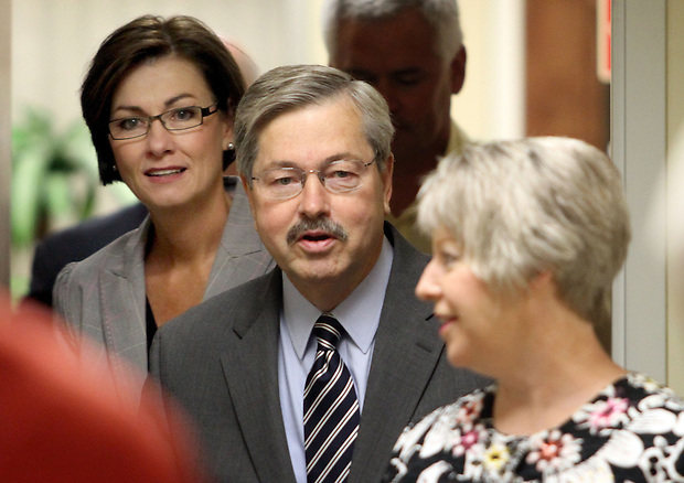 Republican candidate for governor Terry Branstad, center, and his wife, Chris, right, make their way down a hallway with state Sen. Kim Reynolds of Osceola moments before Branstad announced Reynolds as his running mate Thursday morning, June 24, 2010, in Ankeny.