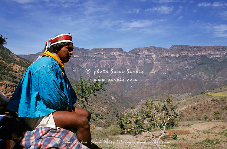 Tarahumaran Indian looks out onto the Sierra Madre Mountains, Mexico.