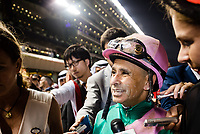 DUBAI, UNITED ARAB EMIRATES - MARCH 25: Mike Smith moves from the winners circle to the presentation area after Arrogate wins the Dubai World Cup at Meydan Racecourse during Dubai World Cup Day on March 25, 2017 in Dubai, United Arab Emirates. (Photo by Douglas DeFelice/Eclipse Sportswire/Getty Images)