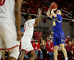 VERMILLION, SD - JANUARY 19: Alex Arians #34 of South Dakota State Jackrabbits spots up for a jumper over Stanley Umude #0 of South Dakota Coyotes at the Sanford Coyote Center on January 19, 2020 in Vermillion, South Dakota. (Photo by Dave Eggen/Inertia)