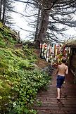 USA, Alaska, Homer, China Poot Bay, Kachemak Bay, a young boy heading to the sauna located at the Kachemak Bay Wilderness Lodge