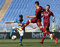 Football, Serie A: AS Roma - SSC Napoli, Olympic stadium, Rome, March 31, 2019. <br /> Napoli's Helseid Hysaj (l) in action with Roma's Diego Perotti (r) during the Italian Serie A football match between Roma and Napoli at Olympic stadium in Rome, on March 31, 2019.<br /> UPDATE IMAGES PRESS/Isabella Bonotto