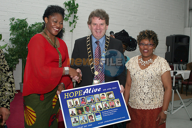Benedicta Attoh with Mayor Michael O'Dowd and Yinka Dixon at the gathering of the 2009 local election African Candidates...Photo NEWSFILE/Jenny Matthews.(Photo credit should read Jenny Matthews/NEWSFILE)....This Picture has been sent you under the condtions enclosed by:.Newsfile Ltd..The Studio,.Millmount Abbey,.Drogheda,.Co Meath..Ireland..Tel: +353(0)41-9871240.Fax: +353(0)41-9871260.GSM: +353(0)86-2500958.email: pictures@newsfile.ie.www.newsfile.ie.FTP: 193.120.102.198.