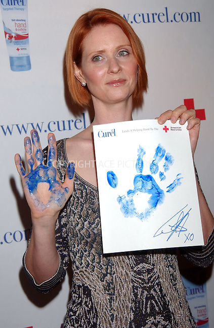 WWW.ACEPIXS.COM . . . . . ....November 1 2007, New York City....Actress Cynthia Nixon starts the Curel Skin Care's Helping Hand Wall to benefit the American Red Cross at the Time Warner Center....Please byline: KRISTIN CALLAHAN - ACEPIXS.COM.. . . . . . ..Ace Pictures, Inc:  ..(646) 769 0430..e-mail: info@acepixs.com..web: http://www.acepixs.com