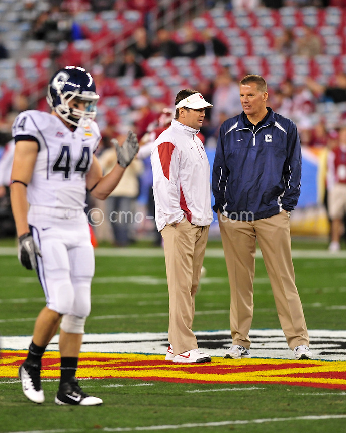 Jan 1, 2011; Glendale, AZ, USA; Connecticut Huskies head coach Randy Edsall and Oklahoma Sooners head coach Bob Stoops talk at mid-field prior to the 2011 Fiesta Bowl at University of Phoenix Stadium.  The Sooners won the game 48-20.