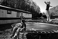 "Gilbert, WV, USA, October 26 2008.Stevie Dawn, 12, flying on the trampoline is the daughter of local pastor Steve Dawson, she wants to become a photographer because ""every picture has a meaning to it""..Her cousin Kailey, 10, watches her with admiration."
