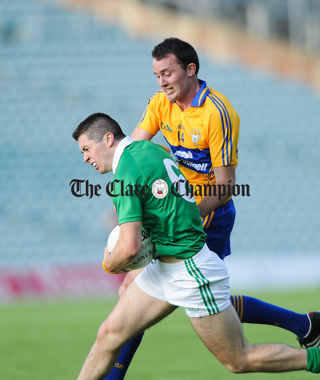 David Tubridy of Clare in action against John Riordan of Limerick during their  Senior championship semi-final at the Gaelic Grounds. Photograph by John Kelly.