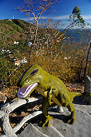 Dinosaur statue on the steps leading to the summit of Nui Lon (Big Mountain). At a lower level the steps pass the Virgin Mary and Baby Jesus Statue, Our Lady of Bai Dau Shrine, on Nui Lon (Big Mountain). Vung Tau, Vietnam.