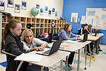 November 15, 2011. Mooresville, NC.. Mrs Rigby, a 5th grade science teacher at East Mooresville Intermediate School, helps a student with an in class lesson. Many of the exercises are executed on the school issued laptops and turned in electronically.. The Mooresville school system has become nationally known for being on the cutting edge of using technology as an educational tool. Starting in 3rd grade, each student is issued their own laptop that they will use in class and at home to further their learning.