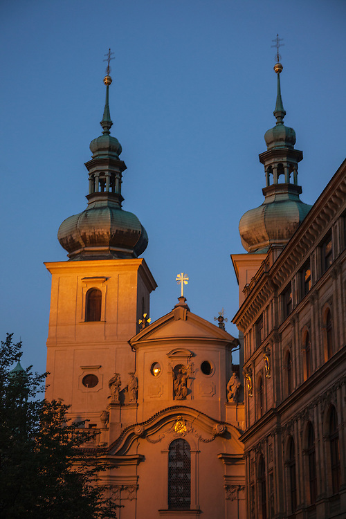 A small church nestled in a back street in the Old Town area of Prague basques in floodlights.