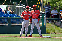 Batavia Muckdogs designated hitter Jerar Encarnacion (27) talks with manager Mike Jacobs (17) during a game against the Auburn Doubledays on June 17, 2018 at Falcon Park in Auburn, New York.  Auburn defeated Batavia 10-6.  (Mike Janes/Four Seam Images)