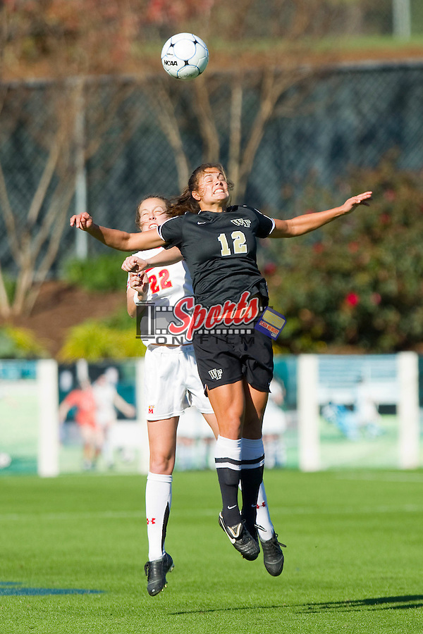 Katie Stengel #12 of the Wake Forest Demon Deacons leaps for a ball in front of Colleen Deegan #22 of the Maryland Terrapins at the 2010 ACC Women's Soccer Championship at WakeMed Soccer Park on November 7, 2010 in Cary, North Carolina.  The Demon Deacons defeated the Terrapins 3-1 in penalty kicks.  Photo by Brian Westerholt / Sports On Film