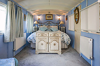BNPS.co.uk (01202 558833)<br /> Pic: PurpleBricks/BNPS<br /> <br /> First class ticket.. clear signs of a railway heritage in the shape of this bedroom. <br /> <br /> This £475,000 seaside cottage contains a charming secret – it's built around two Victorian railway carriages.<br /> <br /> The 19th century carriages were used as temporary housing for soldiers returning from the First World War when there was a shortage of homes.<br /> <br /> But many of them remained in place years later and had bricks and mortar built around them.<br /> <br /> And so from the street view they looked like normal houses but inside the main reception rooms were with the converted carriages.