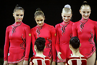 September 25, 2003; Budapest, Hungary; Team Russia (L-R) ALINA KABAEVA, IRINA TCHACHINA, OLGA KAPRANOVA, VERA SESSINA...here with team Ukraine in foreground, win team gold at 2003 World Championships.