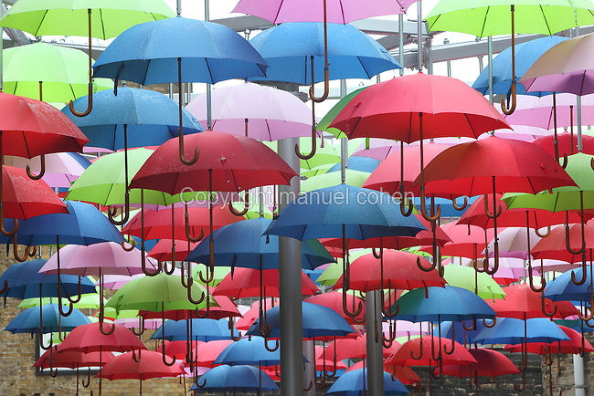 Multi-coloured umbrellas hanging, London Bridge, UK. Picture by Manuel Cohen