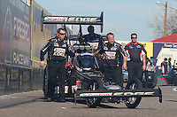 Feb. 22, 2013; Chandler, AZ, USA; Crew members push the car of NHRA top fuel dragster driver Brittany Force during qualifying for the Arizona Nationals at Firebird International Raceway. Mandatory Credit: Mark J. Rebilas-