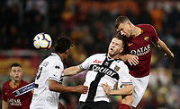 Football, Serie A: AS Roma - Parma, Olympic stadium, Rome, May 26, 2019. <br /> Roma's Edin Dzeko (r) in action with Parma's Riccardo Gagliolo (c) and Bruno Alves (r) during the Italian Serie A football match between Roma and Parma at Olympic stadium in Rome, on May 26, 2019.<br /> UPDATE IMAGES PRESS/Isabella Bonotto