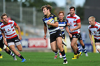 Max Clark of Bath Rugby in possession. West Country Challenge Cup match, between Gloucester Rugby and Bath Rugby on September 13, 2015 at the Memorial Stadium in Bristol, England. Photo by: Patrick Khachfe / Onside Images