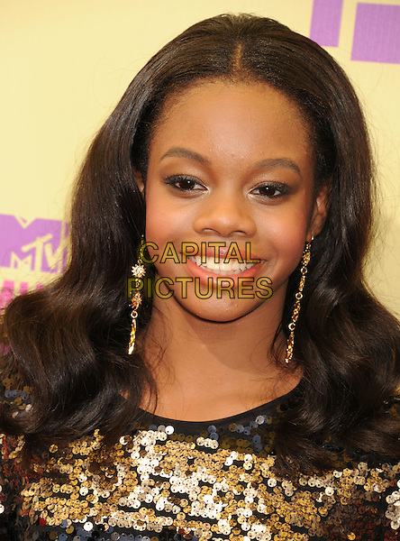Gabby Douglas.arriving at the 2012 MTV Video Music Awards at Staples Center in Los Angeles, California, USA, .September 6th, 2012..arrivals vmas vma  portrait headshot   gold black striped earrings  sequined sequin .CAP/ROT/TM.©TM/Roth Stock/Capital Pictures