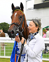 Yourtimeisnow with groom in the winners enclosure after winning The Shadwell Dick Poole Fillies' Stakes during the Bathwick Tyres & EBF Race Day at Salisbury Racecourse on 6th September 2018