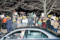 Anti-Trump protesters gather near the Sheraton Portsmouth Harborside Hotel in Portsmouth, New Hampshire, USA. At the hotel later that evening, Republican presidential candidate and real estate mogul Donald Trump received an endorsement from the New England Police Benevolent Association executive council. Many protesters expressed disagreement with Trump's recent statements that he would ban all Muslims from entering the country. Trump brought up the recent shooting in San Berdardino, Calif., at the meeting. A small group of perhaps 20 Trump supporters stood outside the hotel. One of the protest organizers estimated that there were around 230 protesters gathered.